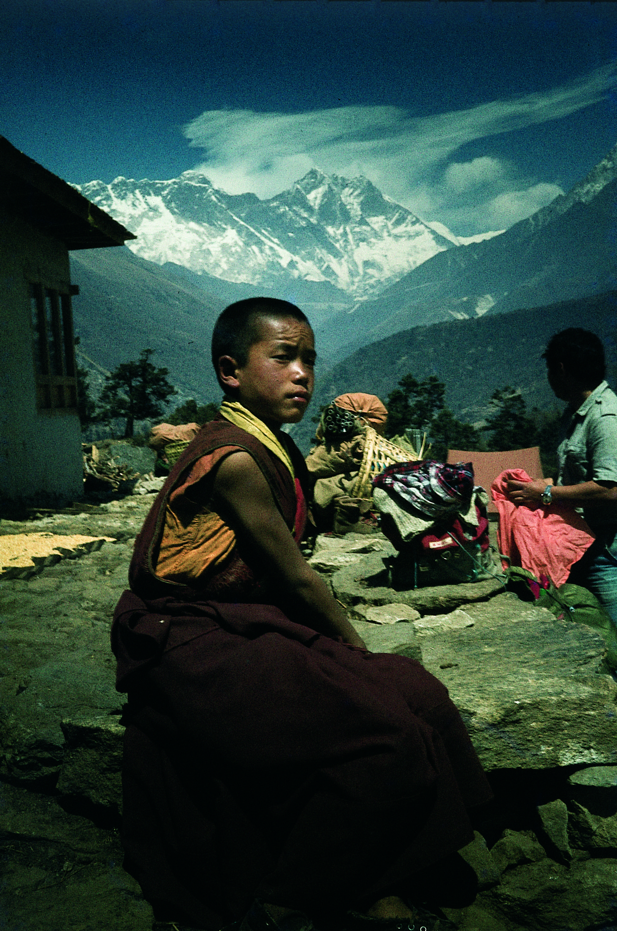 Buddhist boy in Thangboche monastery with Mount Everest in the background
